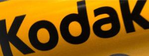 "Yellow sign that says, ""Kodak"""