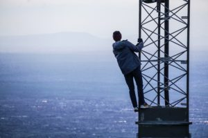Man standing on a cellphone tower