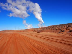 empty desert with smoke stacks